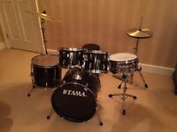 """7 piece Tama drum set (pictured) with 1 extra 20"""" cymbal & adjustable stool in very good condition"""