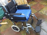 FOLDING WHEELCHAIR IN GOOD CONDITION HAS BRAKES,SEAT BELT AND SPECIALIZED CUSHION CAN DELIVER
