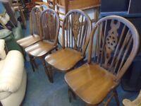 4 wheel back farmhouse dining chairs.