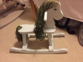 Quaint wooden rocking horse