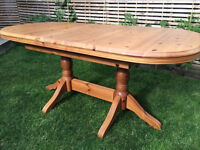 Beautiful solid pine oval extendable dining table