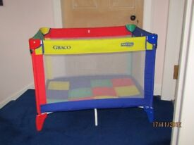 Graco collapsible travel cot.