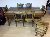 beautiful mango wood dining table and 6 chairs & machine nest of table. excellent condition.