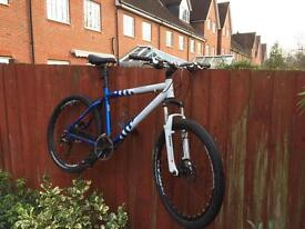 Mountain bike - (giant brand) medium size disc brakes.