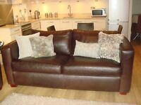 brown leather sofas, matching 3 seater and 2 seater ,top quality