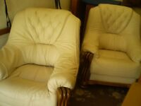 pair of cream leather chairs in wooden frames, very good condition
