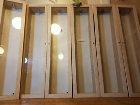 "6 wall cabinets with hinged doors (no shelves inc) 5 foot tall 18"" across 10"" deep."