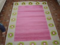 New girls pretty pink rug great for bedroom.