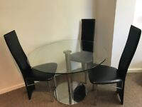 Glass dinning table and 3 chair set