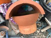 Chimney pot hooded cowl