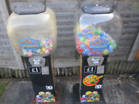TWO DOME VENDING MACHINES .