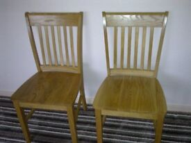 FOR SALE PAIR OF SOLID OAK DINING ROOM CHAIRS.