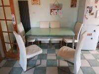 6 seater extendable dining table and 6 chairs