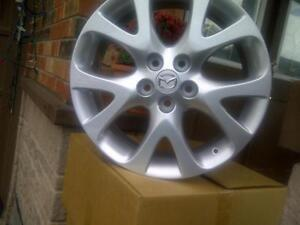 PICKUP FROM BRAMPTON BRAND NEW FACTORY MAZDA 18 INCH ALLOY RIM SET OF FOUR IN BOX.