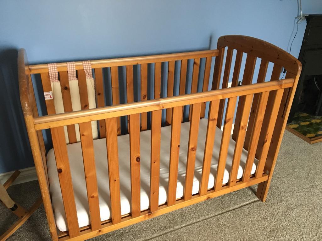 Wooden cot and mattress