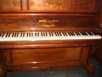 A very fine upright iron framed piano by Seidel & Garn of Berlin, 1924