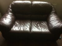 Brown leather love seat- super comfy!