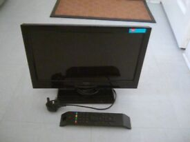 "Television, LED 1691, 1HD TV, 16"", remote control and stand, screen display."
