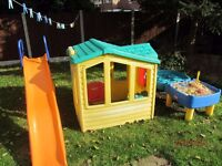 Childrens playhouse and slide