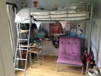 Childs single cabin bed with desk and chair under