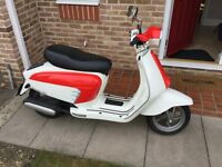 Fantastic as good as new red/white scooter with only 100 miles.