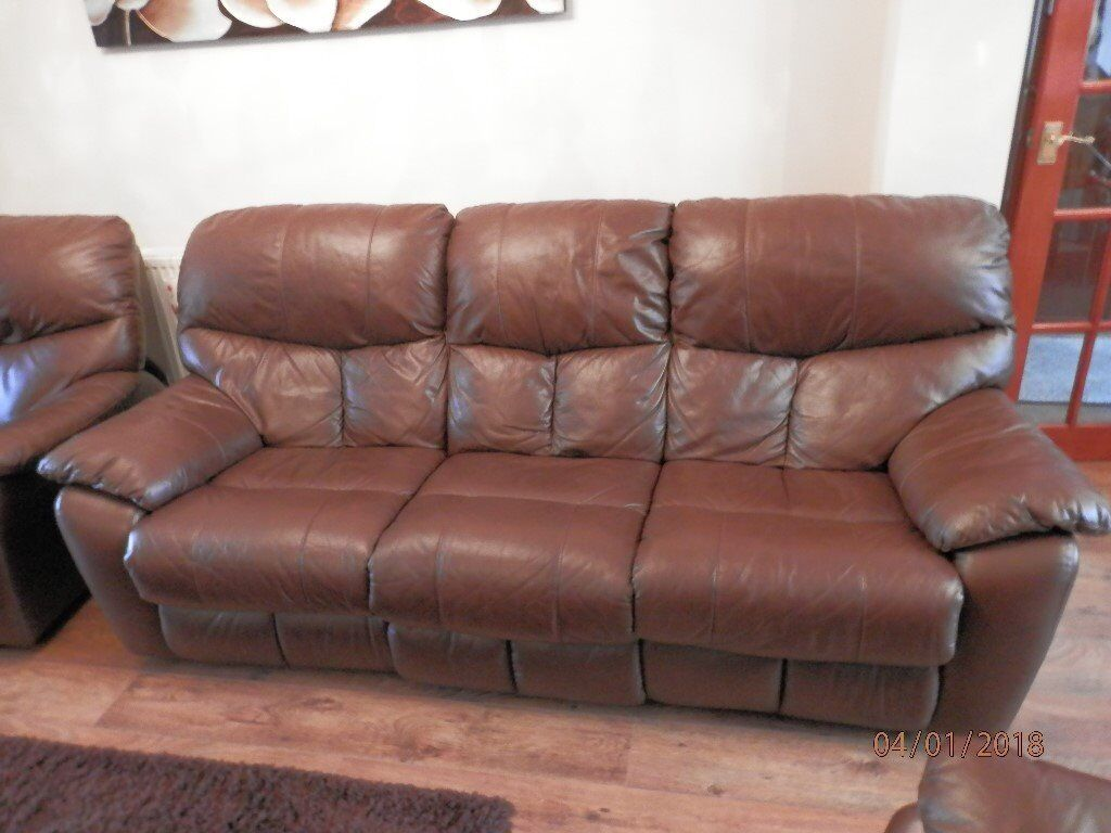 Three Piece Suit In Dark Brown Leather Armchairs Are