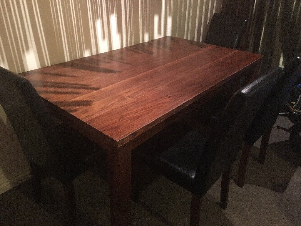 Dark wood dining table and 4 leatherette chairs