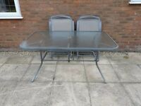 Glass Top Table and Six Folding Chairs in Grey - Water Proof - External or Internal