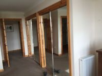 Mirrored wardrobe sliding doors