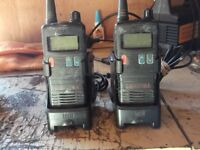 pair ental ht446 uhf submersible walkie talkies & table chargers.