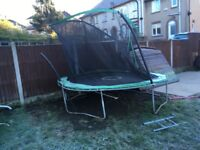 Trampoline and swing set. Trampoline top sorounding bars need attention or can be used with out