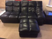 Two seater leather sofa with foot rest