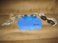 Two Adult Swimming Goggles and a One Size Swimming Cap