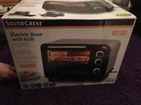 Brand new electric oven and grill - boxed