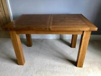 Solid oak butterfly extending dining table 1.3-1.8m