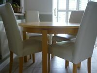 "NEXT Circular 44"" Dining Table extends to 5' and 6' and four cream leather chairs. Good condition"