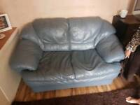 Three and two blue leather sofas