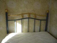 Beautiful wrought iron headboard for a single bed.