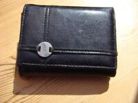 Black faux leather purse, with coin & note compartments. VGC. £1.00. Can post