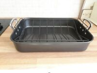 Large heavy good quality roasting tin and rack.