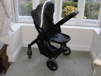 Graco Evo puschair, black and silver. Forward/back facing, large storage area, foot muff.