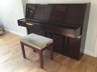 Claremont upright piano