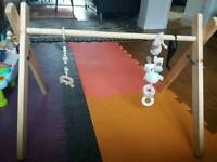 Handmade wooden baby gym + handmade teether and toy