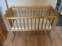 Pine cot/rocker in excellent condition but does not include mattress, stained honey colour.