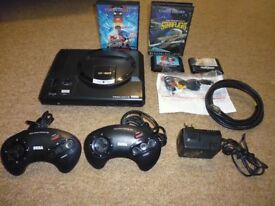 Sega Megadrive console inc 2 pads and Four games