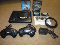 Sega Megadrive console inc 2 pads and Four games