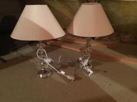 A pair of glass type lamps and shades