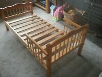 Pine toddler bed with mattress, good used condition