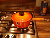 Vintage Volcanic Orange Le Creuset 18 cm Cast Iron saucepan with wooden handle