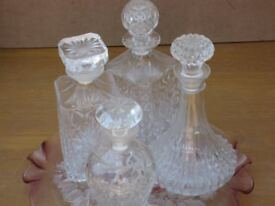 Four Decanters and ornate display dish